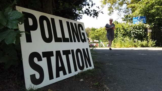 people attend at the prime minitser theresa may's local constituency polling station to vote in the european elections on may 23 2019 in sonning... - vallokal bildbanksvideor och videomaterial från bakom kulisserna