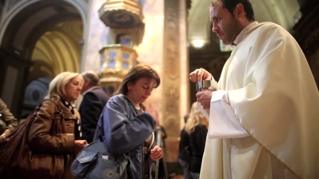 People attend Mass at the Metropolitan Cathedral the former home cathedral of former Buenos Aires Archbishop Cardinal Jorge Mario Bergoglio now known...