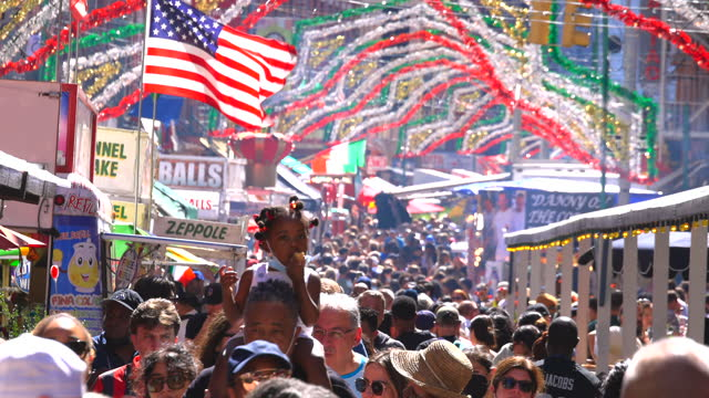 people attend the 95th annual feast of san gennaro on mulberry street in little italy on september 19, 2021 in new york city. the event was cancelled... - baby girls stock videos & royalty-free footage