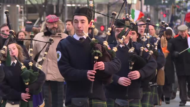 people attend the annual st. patrick's day parade along 5th ave. on march 17, 2018 in new york city. new york's saint patrick's day parade is the... - st. patrick's day stock videos & royalty-free footage