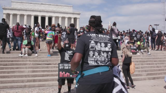"people attend the ""commitment march: get your knee off our necks"" protest against racism and police brutality, on august 28 at the lincoln memorial... - racism stock videos & royalty-free footage"