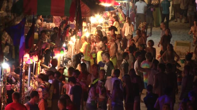 people attend the full moon party on the beach on ko phangan in thailand on jan 4 2015 - ko phangan stock videos and b-roll footage