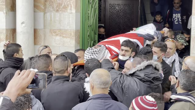 people attend the funeral ceremony of a palestinian prisoner, davud talad el-khatib who died due to heart attack last year in israel's ofer prison,... - death stock videos & royalty-free footage