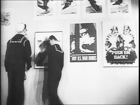people attending a poster art exhibit at the salmagundi club in new york city / man posing as a soldier holding a large ammunition shell for a... - uncle sam stock videos & royalty-free footage