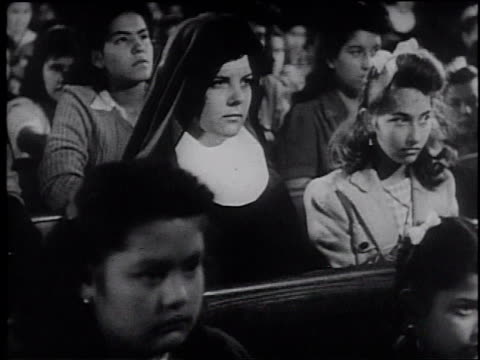 1945 montage people attending mass at a church / united states - frank capra video stock e b–roll
