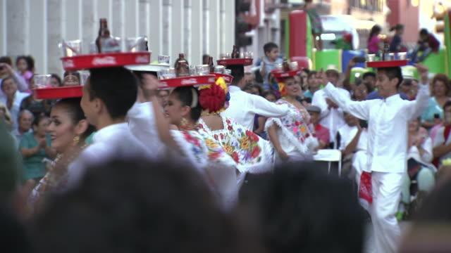 vídeos y material grabado en eventos de stock de people balance trays whilst dancing, mexico - mérida méxico