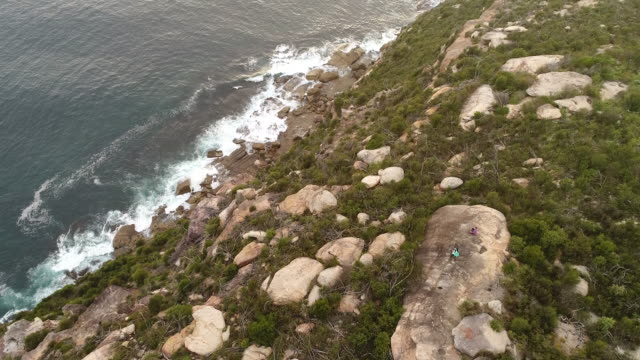 people barrenjoey sit descending - boulder rock stock videos & royalty-free footage