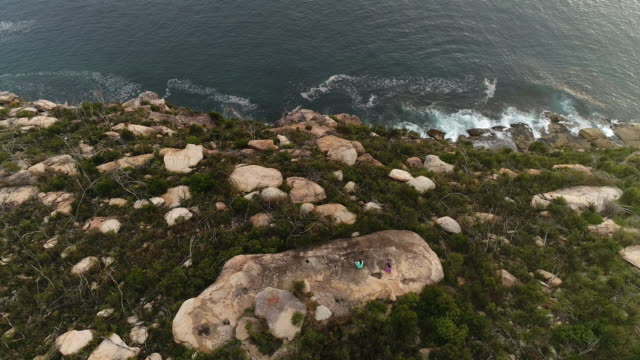 people barrenjoey yoga sit back 2 sea down - boulder rock stock videos & royalty-free footage