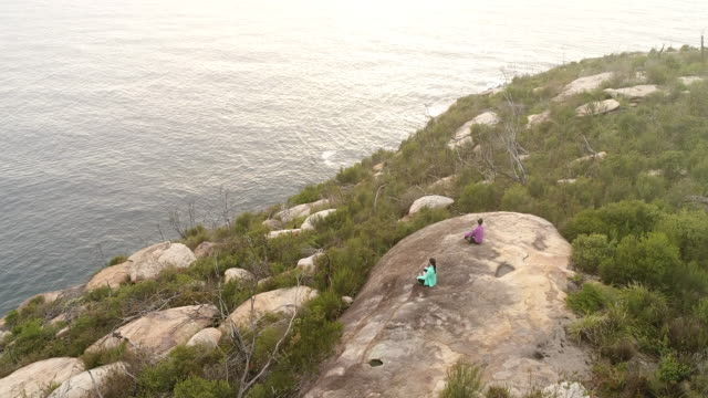 people barrenjoey yoga sit landing face 2 sea - boulder rock stock videos & royalty-free footage