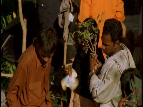cu people bartering outside market stall, bandhavgarh national park, india - national icon stock videos & royalty-free footage