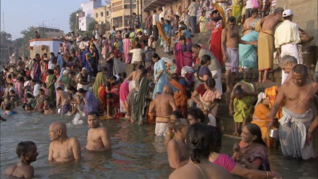 ws pan people bathing and praying in river at steps / varanasi, uttar pradesh, india - semi dress stock videos and b-roll footage