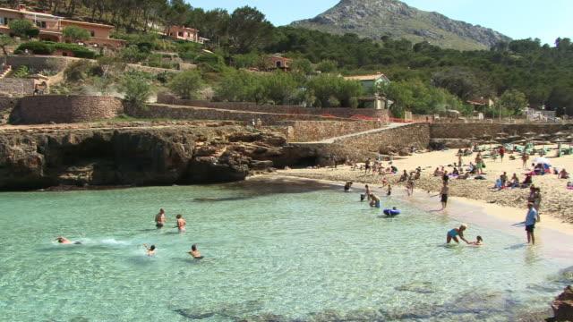 WS, PAN, People bathing in Bay of Cala Molins, Spain, Balearic Islands, Mallorca