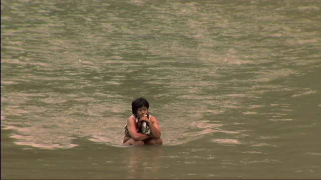 WS PAN TU People bathing in dirty river / Bali, Indonesia
