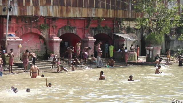 ms people bathing in hooghly riverside / kolkata, west bengal, india - hooghly river stock videos & royalty-free footage