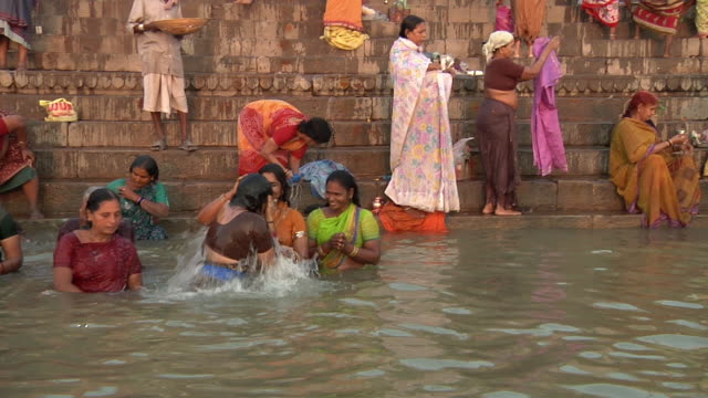 ws pov people bathing in river ganges / varanasi, uttar pradesh, india - traditional ceremony stock videos & royalty-free footage