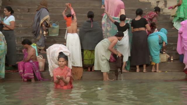 WS POV People bathing in river Ganges / Varanasi, Uttar Pradesh, India