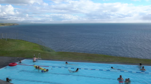 People bathing in the famous Hofsós swimming pool, Northern Iceland