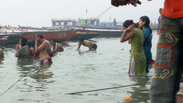 People bathing in the Ganges river.