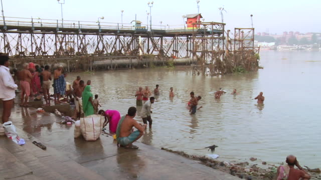 ms people bathing on steps near hooghly river side  / kolkata, west bengal, india - hooghly river stock videos & royalty-free footage