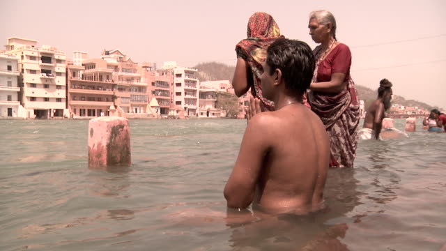 people bathing on the ganges river - semi dress stock videos and b-roll footage