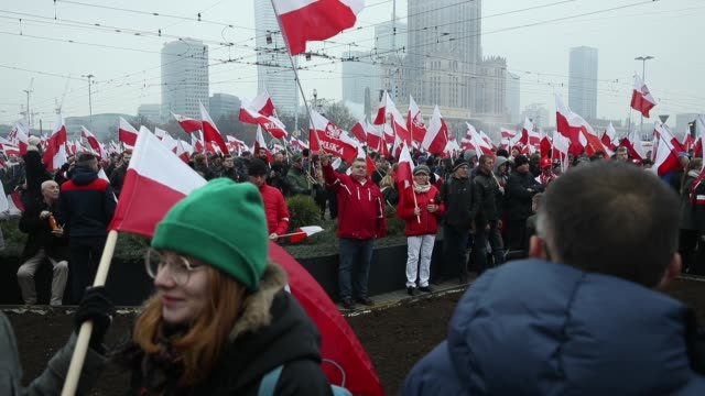 people bearing polish flags and a flags of the polish nationalist group all-polish youth gather prior to the planned march of independence during... - independence stock-videos und b-roll-filmmaterial