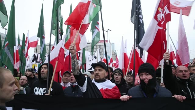 people bearing polish flags and a flags of the polish nationalist group all-polish youth gather prior to the planned march of independence during... - independence video stock e b–roll