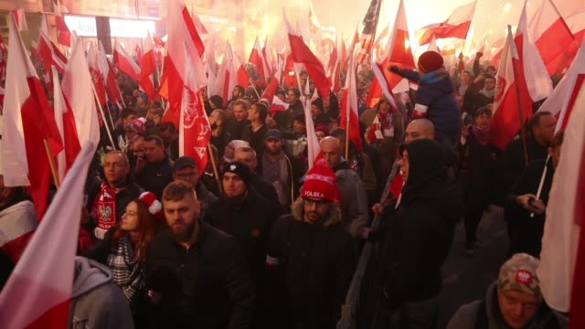 people bearing polish flags and others holding lit flares participate in the march of independence during events to mark the 100th anniversary of the... - independence stock videos & royalty-free footage