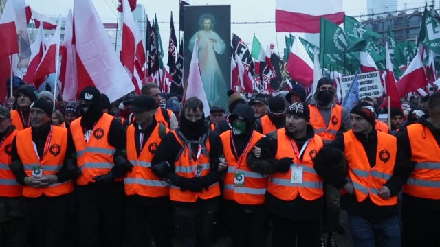 people bearing polish flags as well as flags of the polish ultra-nationalist group national radical camp and the italian ultra-nationalist group... - independence video stock e b–roll