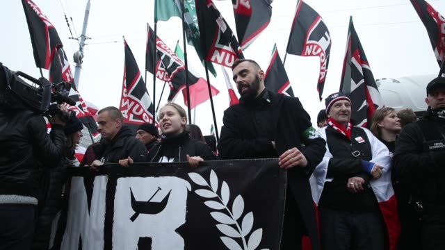people bearing polish flags as well as flags of the polish ultranationalist group national radical camp and the italian ultranationalist group forza... - poland stock videos & royalty-free footage