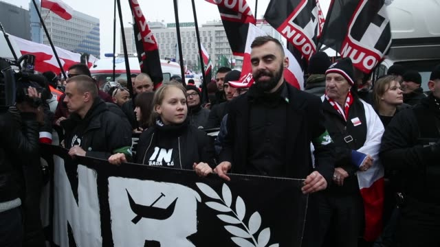 people bearing polish flags as well as flags of the polish ultra-nationalist group national radical camp and the italian ultra-nationalist group... - independence stock videos & royalty-free footage