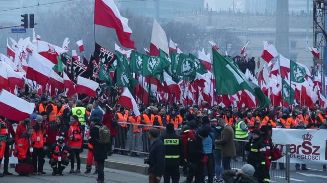People bearing Polish flags as well as flags of the Polish ultranationalist group National Radical Camp and the Italian ultranationalist group Forza...