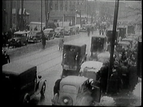 vídeos de stock, filmes e b-roll de montage people being escorted from shut down plants detroit strike enters day 17 / detroit michigan united states - 1930