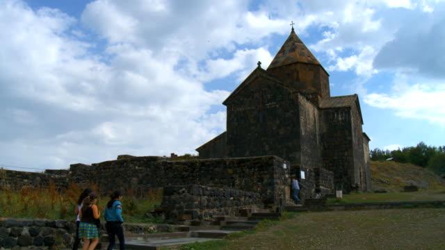 vídeos y material grabado en eventos de stock de ws people being in at sevanavank monastic complex / armenia - península