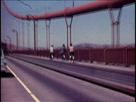 people bicycling across golden gate bridge - 1965 stock videos & royalty-free footage