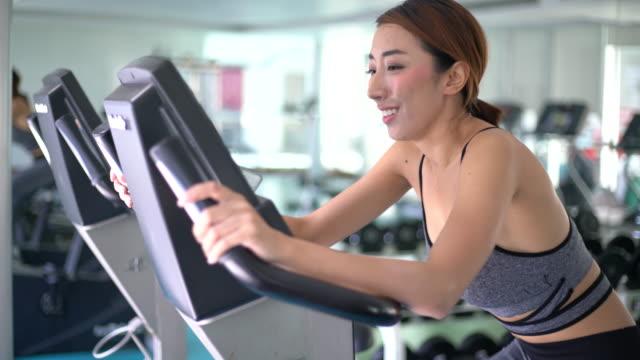 People Biking At Gym, Exercise Bike
