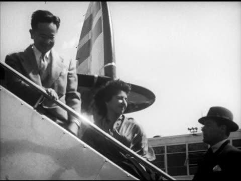 people boarding aircraft walking up aircraft steps tu ms unidentified aircraft propeller turning boy leaning on gate under wing of lockheed super... - flugpassagier stock-videos und b-roll-filmmaterial