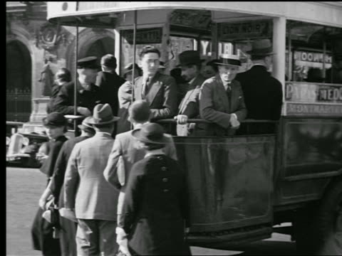 B/W 1927 PAN people boarding crowded bus / Paris, France (jump cut)