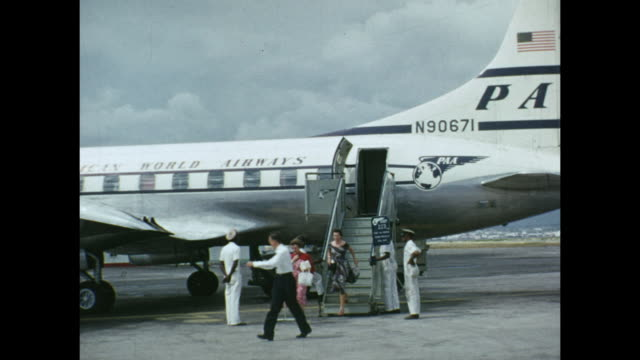 1954 home movie people boarding klm airplane / aruba, lesser antilles  - the past stock videos and b-roll footage