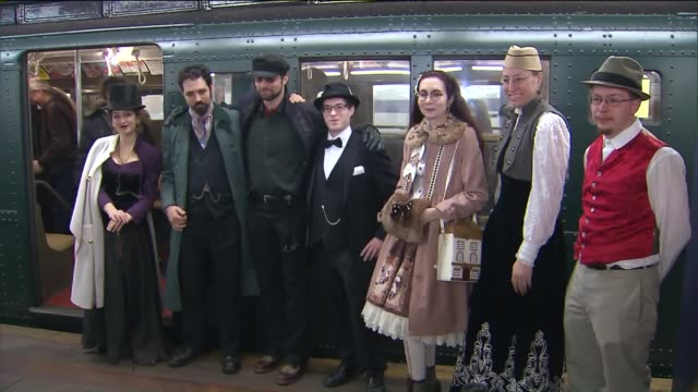 people boarding vintage trains interior and exterior of train the holiday nostalgia fleet includes subway cars from the 1930s and buses from the late... - 1930 stock-videos und b-roll-filmmaterial