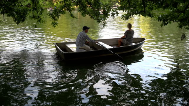 people boating in central park lake, new york city - rowing boat stock videos & royalty-free footage