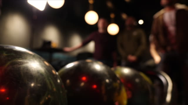 people bowling on a night out - ten pin bowling stock videos & royalty-free footage