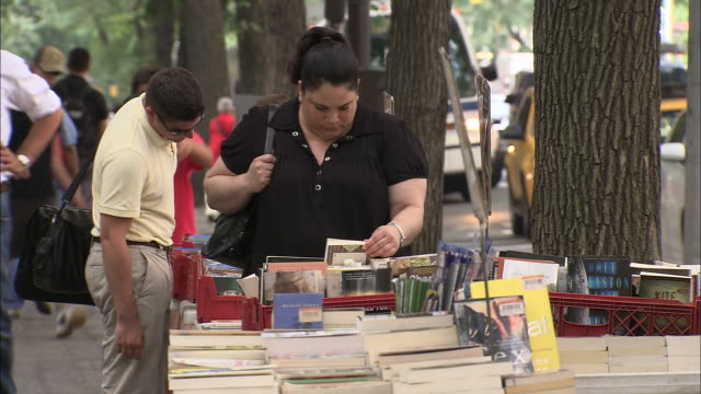 ws people browsing books from booksellers at central park / new york city, new york, usa       - bookseller stock videos and b-roll footage