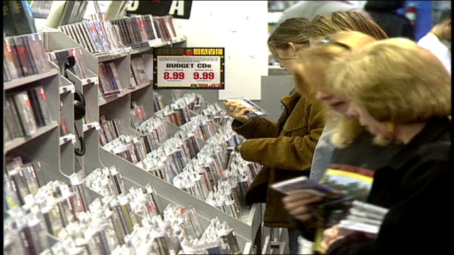 people browsing through cds at tower records in los angeles california - tower records stock videos & royalty-free footage