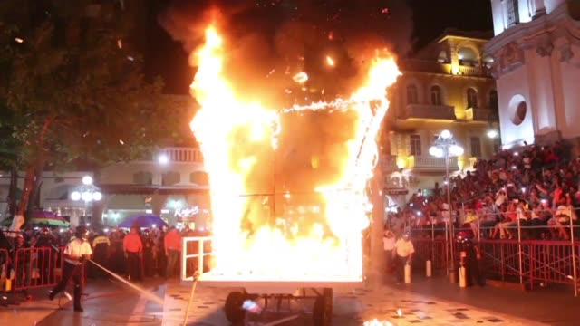 people burn a fake wall in a protest against us president donald trump during the inauguration of the carnival festival in veracruz mexico - president stock videos & royalty-free footage