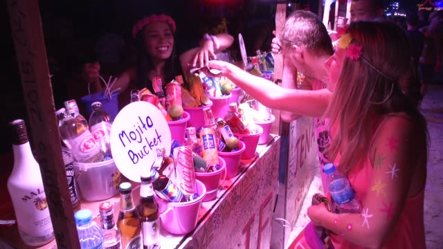 people buy buckets of alcohol during the full moon party on the beach on ko phangan in thailand on jan 4 2015 - ko phangan stock videos and b-roll footage