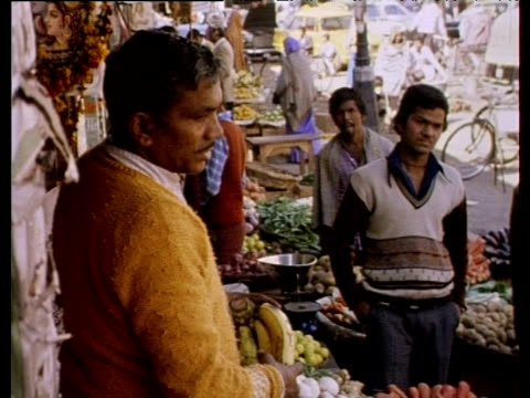 people buy food from market stalls india 1980 - crucifers stock videos and b-roll footage