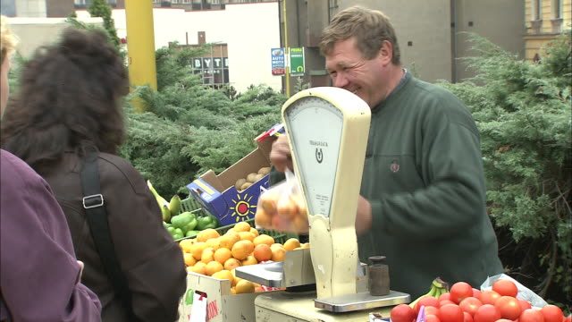 People buy fruit from stall, PrÌbrami, Czech Republic