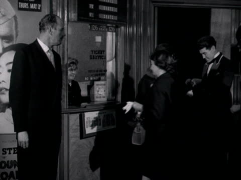 people buy tickets from a cinema kiosk then hand them to an usher before entering the cinema auditorium. 1960. - ticket stock videos & royalty-free footage