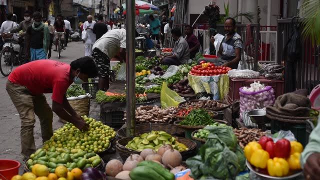 people buy vegetables and fruits at a street market during relaxation hours of the ongoing covid-19 coronavirus lockdown, on june 09, 2021 in... - citrus fruit stock videos & royalty-free footage