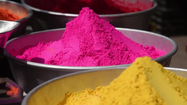 people buying and selling coloured powder ahead of holi festival amid covid-19 pandemic, at busy fancy bazaar on march 25 in guwahati, india. the... - public celebratory event stock videos & royalty-free footage